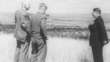 Oliphant, Hancock and Florey survey the site of the new university at the time of the Easter Conference, April 1948
