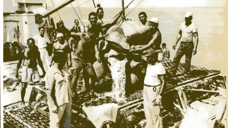 Wharf men loading the last sugar crushed at Nausori Mill before the mill closed on 7 January 1960