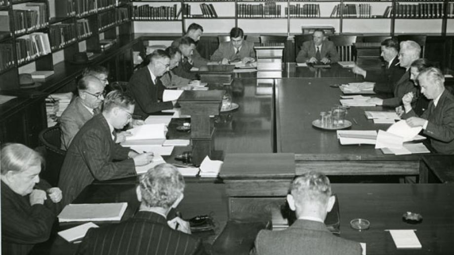 Professor Oliphant with other members of the Academic Advisory Council in discussion with the Interim Council, April 1948