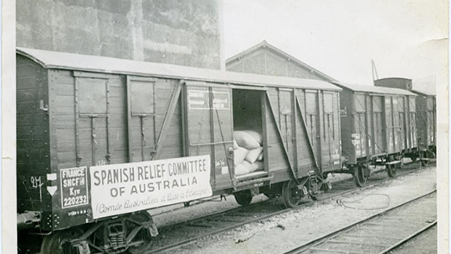 Spanish Relief Committee of Australia banner on the side of a goods train in France
